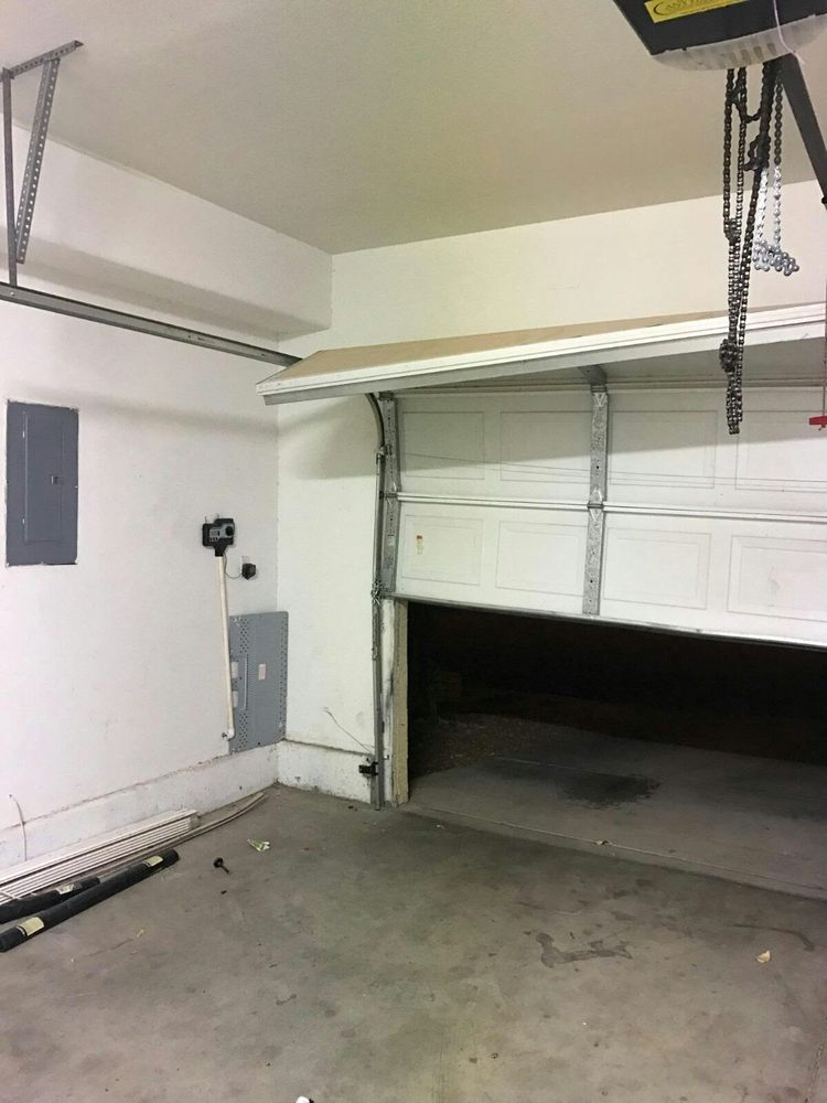 a garage door is a convenient way to access your home or business however if its off of its tracks it can become a serious inconvenience - Garage Door Off Track